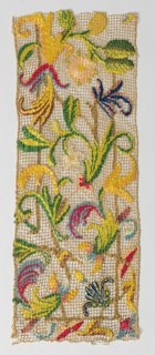 Large-scale multicolored scrolling floral design on light brown knotted net.