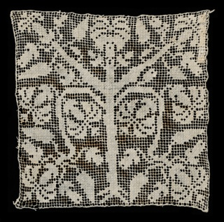Square of net with a darned symmetrical tree pattern.