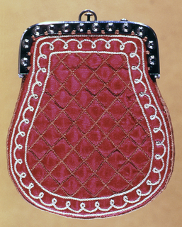 Steel-framed purse in red quilted satin embroidered on the border with a curlicue design in light gray. Two compartments inside and silk lining.