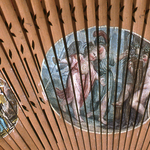 Reversible brise fan. Scenes are engravings on paper, colored. Three medallions on each side in each position, making twelve scenes in all, each being related to love-- cupids, goddesses, etc. Sticks are of wood, carved à jour.