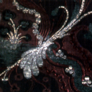 Allover design of flowers brocaded in metal threads on purple silk ground.