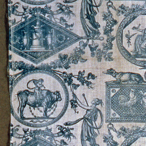 Classical medallions printed in blue on white. Women in classical dress and garlands of grape vine frame medallions containing a sphinx, a winged head flanked by two roosters, a putti riding a bull. Pattern incomplete on left side.