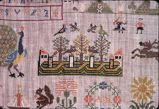 At upper left, box with pattern bands and alphabet; upper right, religious motifs.  Lower field: floral motifs and monogram and date.