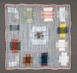 Ten squares of pattern darning and two mended tears.  Inset square in the middle with initials and date.