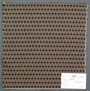Pattern of small checks in black, grey and brown. Warp threads are black and white and weft threads are white with supplementary weft in black, grey and brown.