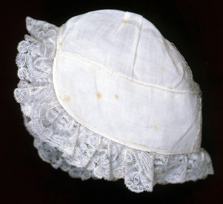 Baby's cap trimmed with lace. Date of 1766 worked in Hollie Point on the crown.