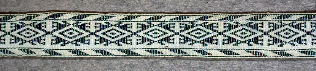 Narrow belt with a band of geometric ornament.