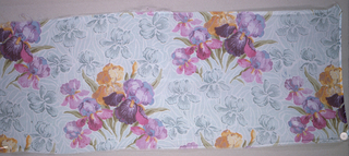 Three samples of printed chiffon, with a design of solidly massed iris blossoms and foliage. Both selvedges present on all samples.