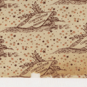 """Printed cotton with a repeating design of laurel branches with a scroll which reads """"The Constitution must be Preserved,"""" on a background sprinkled with stars. Printed in brown, tan and pink on an ivory ground. Printed in support of the Constitutional Union Party's presidential candidate, John Bell, in 1860."""
