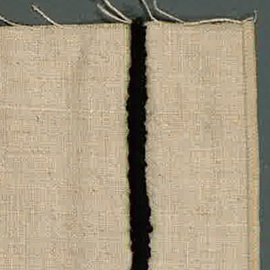 Plain weave in beige with applied stripe in black yarn. Yarn is looped and stitched to the surface of the plain weave.