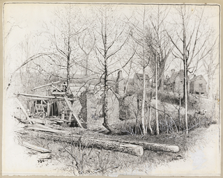 In the foreground the view of a mill. In the background, several small houses. Several tree trunks in the foreground.