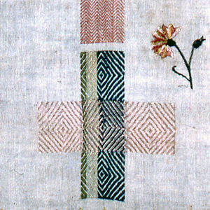 Eight darning crosses and one patch insertion.  Date and crowned initials in the center.