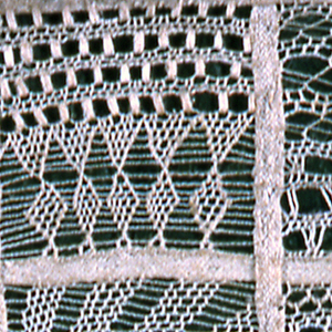 Braided tape sewn into grid formation, filled in with needlelace.