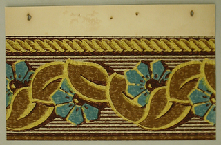 Reapeating swag ofbrown leaves and bluem angular flowers. Top of border is a yeallow, twisted rope design. Background is thin borwn stripes on a white background.