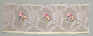 Sample with muted purple satin ground has a twill woven design of slender serpentine branches and ornamental leaves forming irregular ovals. Enclosed within each oval is a small-scale rose spray in polychrome silks. Both selvages present.