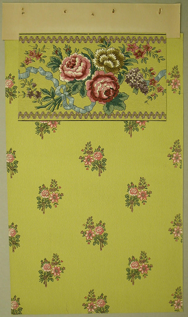 Three large flowers tied together at the stem with a blue bow with smaller bunches of flowers floating in the background. Top and bottom of border have a muted lime-green line with a dusty pink ribbon loosely wrapped around it. The background is a lighter dusty lime-green.