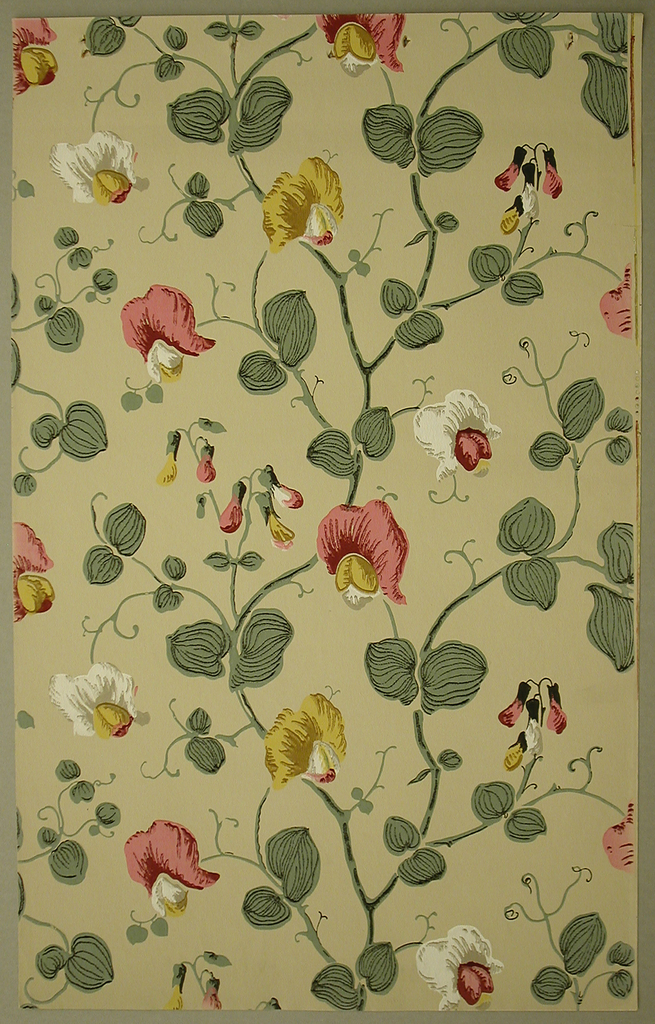 Repeating decoration of thin, twisting vines with rounded green leaves and semi-circular shaped flowers in white, pink, and yellow, and elongated buds in the same color. The background is a solid taupe.