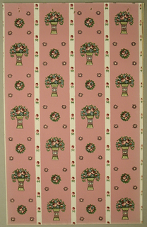 Art Deco sidewall with design of off-set columns formed from two alternating motifs; one motif a small circular cluster of roses surrounded by four small sunburst motifs marking the corners of a square; the other motif a bouquet of roses in a decorated vase with concave sides; columns separated by white bands decorated with regularly-spaced small roses; naturalistic colors and shading on foliage; pink ground.