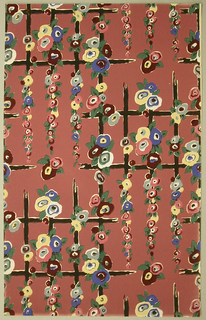 Art Deco sidewall with all-over design of rectilinear black lattice decorated with hanging clusters of flowers; rectangular repeat in off-set columns; flowers formed from concentric blobs of white and pink, dark red, yellow, or blue with small green leaves at their edges; lattice has gaps in places as if rotted away; brick red ground.