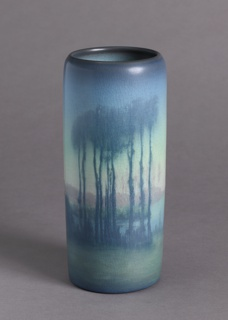 Cylindrical body, slightly rounded inward at top.  Underglaze painting of misty landscape with lake and tall trees in foreground.  Cracked mat glaze.  Bottom stamped.