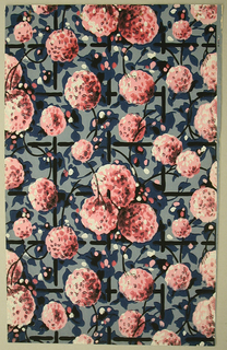 Art Deco sidewall with all-over design of black lattice entwined with vines bearing large pom-pom-like pink flowers; vines are black with blue splotchy leaves and covered with irregular daubs of pink, red, and white; flowers detailed with rough dabs of black, white, red, and dark red; light blue ground.