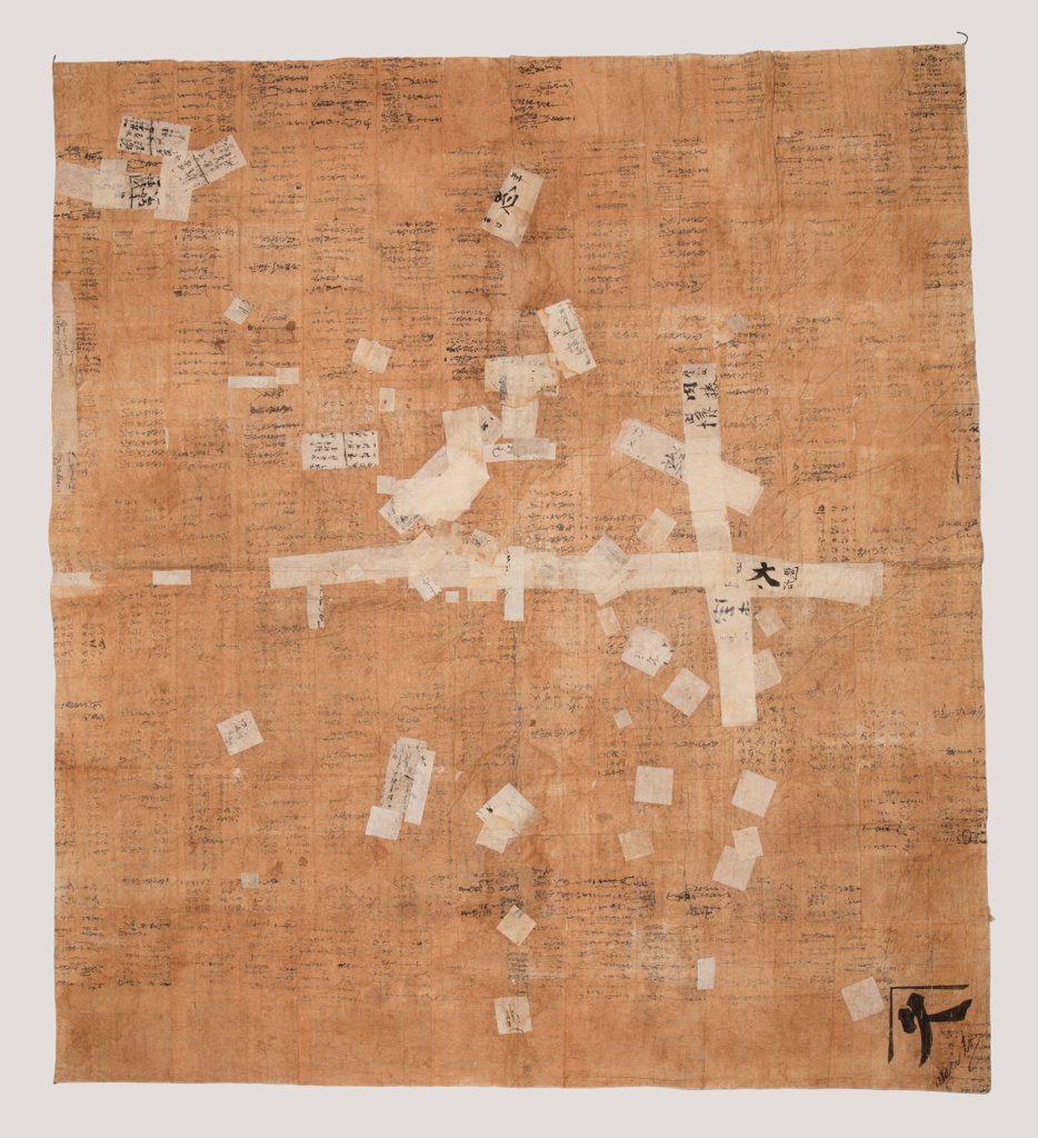 Large wrapping cloth made from sheets of paper from account ledgers, glued together and stained with persimmon, giving a brownish color except where later patched with lighter colored papers. Writing still evident on sheets.