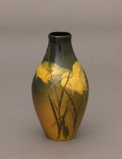 White clay body, cast.  Ovoid body, decorated with two herons flying along rushes.  Birds in underglaze white slip (appear yellow) and rushes in green.  Against a shaded background of ochre, forest green, sage green, brown and russet.  Yellow glaze overall.  Bottom and interior glazed.