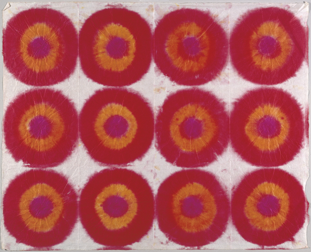 Twelve concentric circles in red, orange and pink arranged in rows.