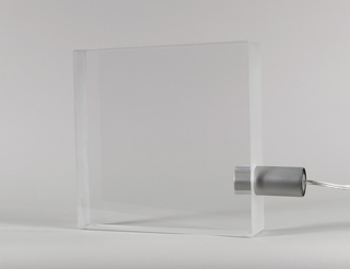 Body composed of thick, transparent methacrylate square with removeable aluminum bulb housing inserted in lower section of one side.