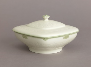 Covered square-rimmed bowl with round foot. All white but for beige details around bowl's rim and border of lid. Impressed wave pattern; finial in shape of blossom.