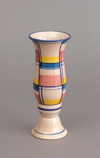 Baluster-shaped vase rising from a flared circular foot; pale rose ground with horizontal and vertical lines dividing the surface into rectilinear passages of bright rose, yellow, and light blue.