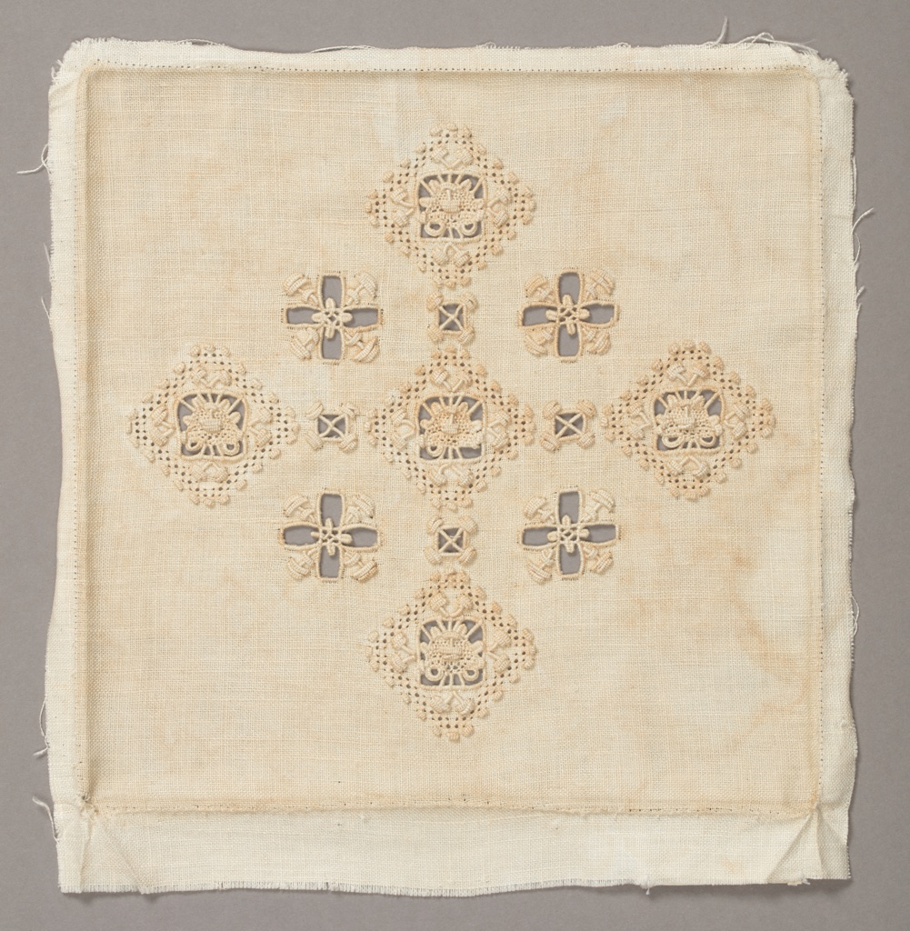 """An altar set of four pieces in ivory linen embroidered with ivory linen. Embroidery and cut-work forms a grid of squares with crosses in the centers. Components """"a"""" and """"b"""" are chalice veils. Component """"a"""" is completely covered with embroidery while """"b"""" has cross motif at the top. Components """"c"""" and """"d"""" are burse covers with a single cross in the center."""