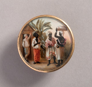 Button depicting scene with four figures in a landscape with palm trees. At left, a light-skinned man at entrance of a hut, as black-skinned man and woman, dressed in Western style working clothes, converse with another woman who wears only a skirt, carrying a child on her back and a package on her head.
