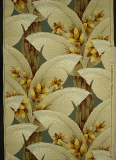 Large-scale foliate pattern with large flat leaves and floral stems sprouting of a woody stalk.