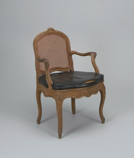 Louis XV style armchair, caned, with leather seat