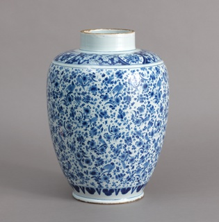 Large ovoid jar, tall straight-sided neck, slightly flattened foot; painted in underglaze blue on white with overall floral and bird pattern with leaf band bottom and floral reserve band at shoulder; high domed cover with wide flat base, acorn finial, decorated with floral and bird pattern.