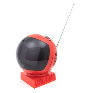 Spherical red television with convex screen at front; square base; control knobs and hanging/carrying chain in indentation at top; chrome-plated telescoping attenna, top right.