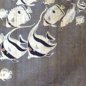 Underwater scene of tropical fish, seaweed, snails, starfish and anemones.