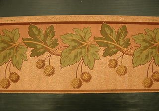 Pairs of chestnuts suspended from vining foliage. Background darker terra cotta above foliage, lighter, textured color below. Narrown color band runs along either edge.