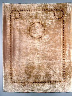 Curtain of light brown velvet, stenciled in a simple design of reddish-brown; a central circle and side border.