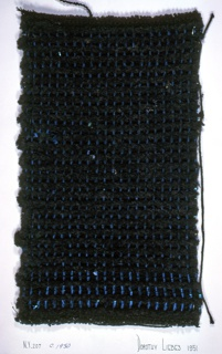 Plain weave with paired warps black boucle and chenille yarns with blue metallic yarn. Warp has two-ply black cotton and black boucle in pairs. Weft is black chenille alternating with flat blue metallic paired with narrow black thread.