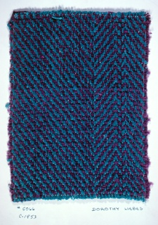 Symmetrical 2 and 2 horizontal twill in purple and blue. Warp: aqua yarn.  Weft: purple chenille alternating with 2 ply purple yarn paired with flat blue synthetic metal.