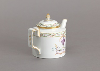 Cylindrical, slightly outcurved spout, rectangular strap handle, slightly domed cover with pineapple finial. Decoration, in pale colors, of an urn with foliate rinceaux, and bands of foliage in color and gilding. Bottom unglazed.