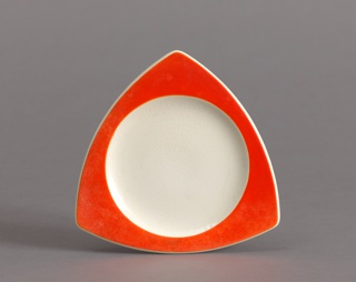 Small triangular plate with curved red rim and circular white well.