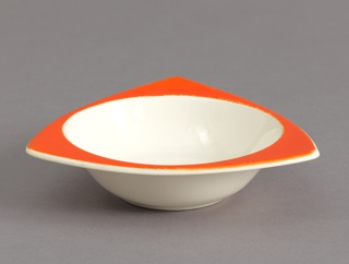 Circular bowl having white interior and red triangular rim wth curved edges.