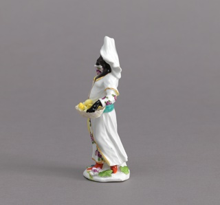 Blackamoor Figure of a Fruit Vendor Figure