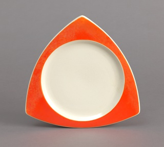 Triangular plate with curved red rim and circular white well.