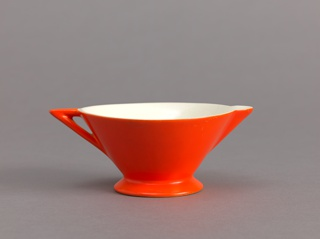Of  inverted cone shape with triangular spout on one side and triangular handle oposite; white interior and red-orange exterior.
