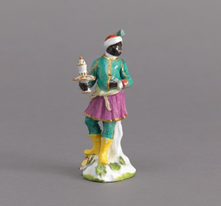 Turbaned black male holding covered cup on tazza.
