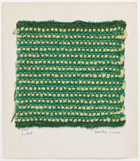 Woven sample mounted to a cardboard card with notations by the designer. Dark ground with narrow horizontal white stripes. Warp is paired two-ply yarn and bouclé yarn in two shades of green. Weft is a repeating sequence of green chenille yarn, blue braided tubing and two strands of white chenille yarn.